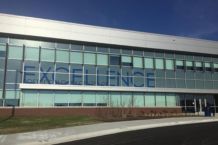 Building that has the word excellence on it