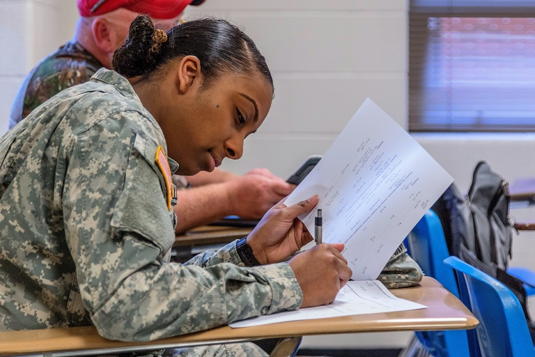 woman in military uniform taking a test