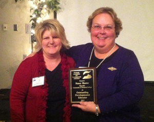 Kim Toby presenting Nancy Hunter with Development Education Award