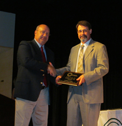 image of Russ Ward receiving the educator of the year award