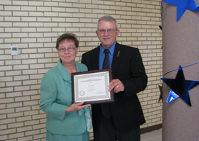 image of Gail Merrill receiving the KYAE Volunteer of the Year award with Bill Teegarden