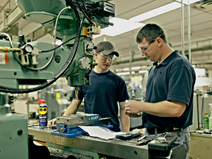 image of instructor and student in computerized manufacturing lab working on project together