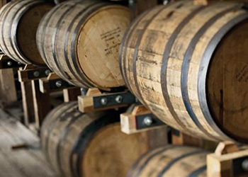 Stacked wooden barrels.