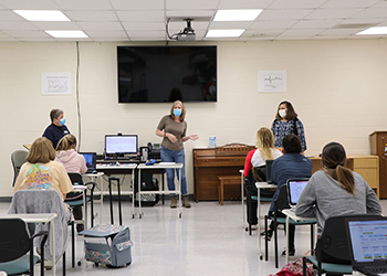 Angela Gray and Janelle Delaney speaking in front of the nursing class at the Licking Valley Campus.