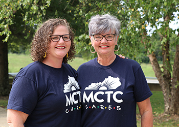 A photo of Maggie Price and her mother Tina Curtis, wearing matching shirts that read