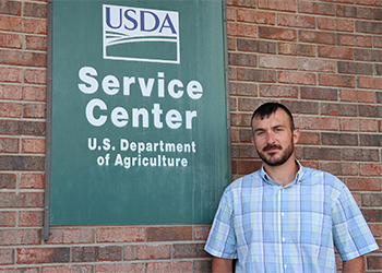 Clay Stamm in front of USDA Service Center