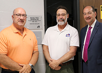 Stanley Click, Russ Ward, and Rocky Adkins in front of welding lab.
